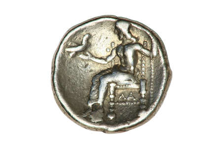 Greek silver Tetradrachm coin from Alexander the Great showing a seated Hercules, dated 336-323BC. Stock Photo
