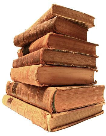 shelve: Pile of well worn antique books.