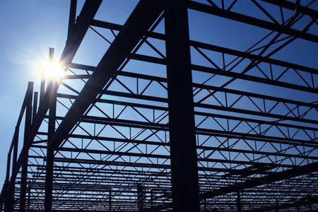 Silhouette of a steel frame building under construction. Stock Photo