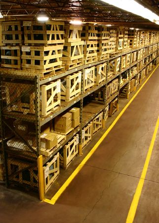 Heavily crated parts of a manufacturers warehouse. Stock Photo