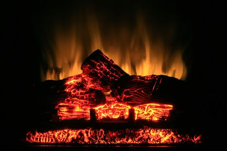 Glow from a realistic looking electric fireplace. photo