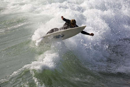adrenaline rush: A surfer stretches to stay on board