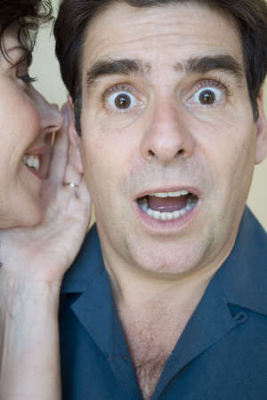 he: Woman whispers in his ear and he is surprised