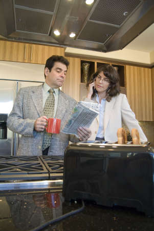 Business couple with toaster and bread photo