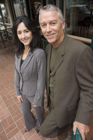 Business couple posing outside