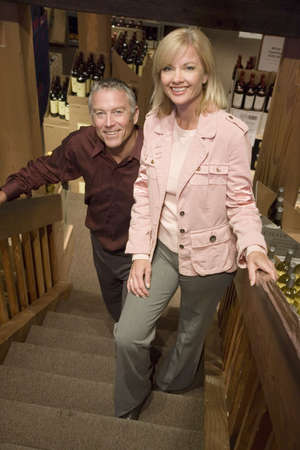 cousin: Couple walking up wine cellar stairs