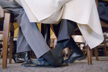 footsie: Man and Woman playing footsie under the table