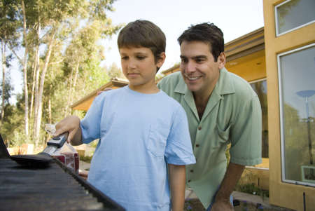 cousin: Father shows son about BBQ Stock Photo