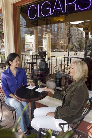 Two woman enjoying drinks outside Stock Photo - 931966