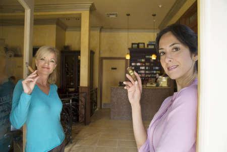 sidewalk talk: Two woman smoking cigars