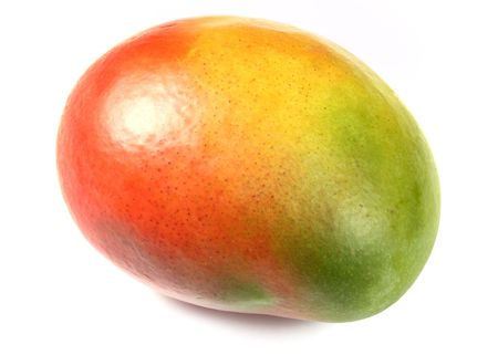 vibrant colours: closeup of mango fruit isolated over white. vibrant colours