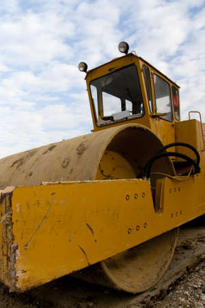 Yellow Roller closeup on a construction site Stock Photo - 7949428