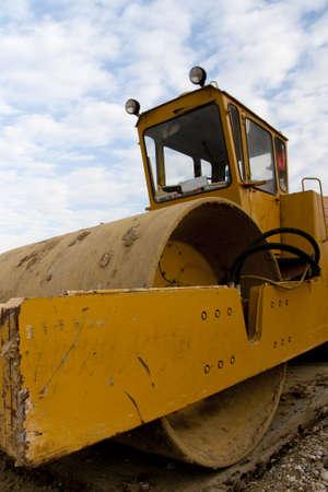 vibroroller: Yellow Roller closeup on a construction site Stock Photo