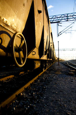 Rusty Freight trains on sunrise with golden reflection photo