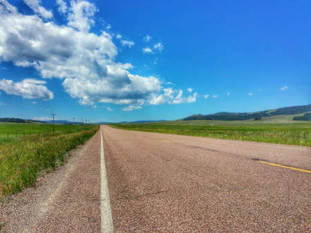 seemingly: A shot if a seemingly unending highway in Montana. Stock Photo