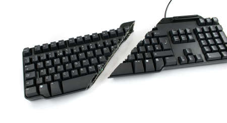 cutback: Modern keyboard cut completely in half showing keys and wires still in place