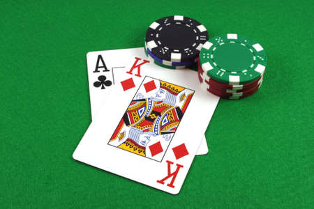 big slick: Big Slick - Ace King with poker chips on a green poker baize Stock Photo