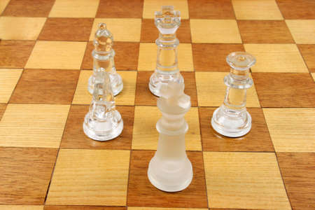outwit: Chess Game -  5 Glass Chess Pieces on a wooden chessboard