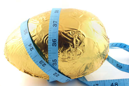 Close up of an easter egg with tape measure  photo