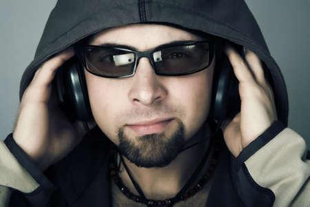 Handsome man in headphones enjoying the music Stock Photo
