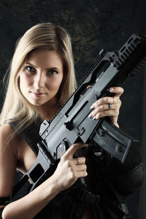 Shot of a beautiful girl holding gun. photo