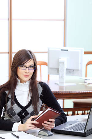 Business theme: beautiful businesswoman working at the office. Stock Photo - 6525988