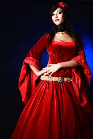 Portrait of a beautiful woman in medieval era dress. Shot in a studio. Stock Photo - 6525990