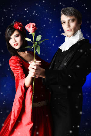 Portrait of a beautiful couple in medieval costumes with vampire style make-up. Shot in a studio. Stock Photo - 6525995