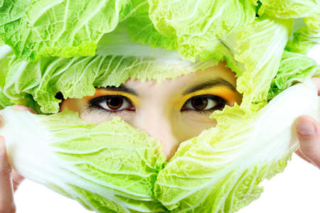 Shot of a beautiful young woman with vegetables headwear. Food concept, healthcare. Stock Photo - 7172257