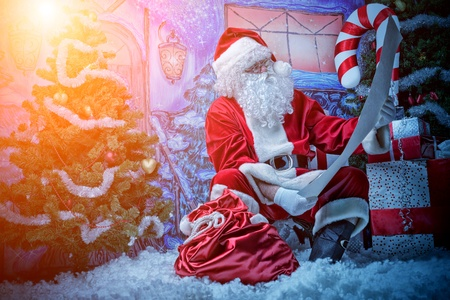 nicholas: Santa Claus posing with a list of presents over Christmas background.