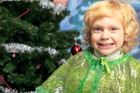 Happy little girl posing in Christmas dress. Stock Photo - 11639270