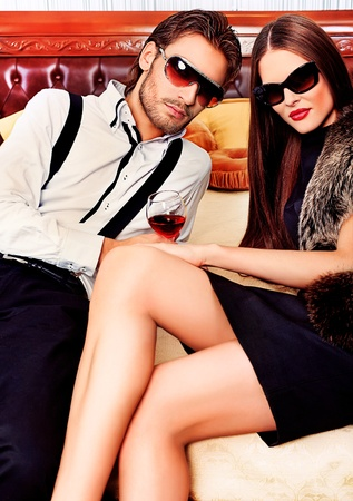 Portrait of a handsome fashionable man with  charming woman posing in the interior. Stock Photo - 11639297