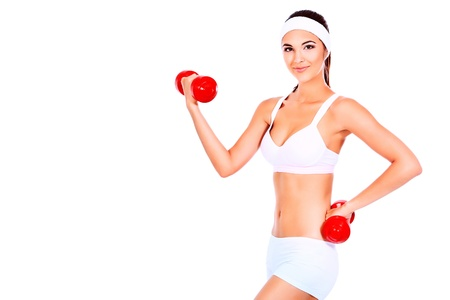 Shot of a sporty young woman with dumbbells  Active sporty life, wellness  photo