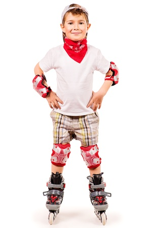 Portrait of a cute smiling boy in roller skates. Isolated over white. photo