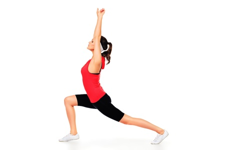 Slender sportive woman doing stretching. Isolated over white background. Stock Photo