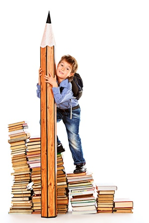A boy climbing the stairs of books with a huge pencil. Education. Isolated over white. photo