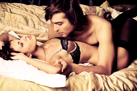 Sexy young couple playing in love games in a bedroom. photo