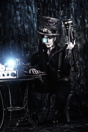 Portrait of a steampunk man over grunge background. Stock Photo - 20672691
