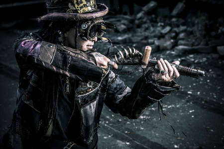 subculture: Portrait of a steampunk man in the ruins.
