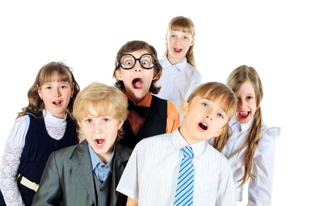 SINGING: Group of children singing in the school choir. Isolated over white.