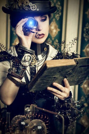 steampunk: Portrait of a beautiful steampunk woman over vintage background. Stock Photo