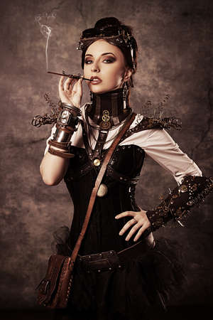 gothic: Portrait of a beautiful steampunk woman over grunge background.