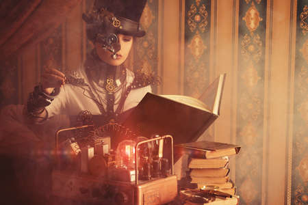 Portrait of a beautiful steampunk woman over vintage background. Stock Photo