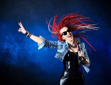 Modern rock singer singing into a microphone. Stock Photo - 20760458