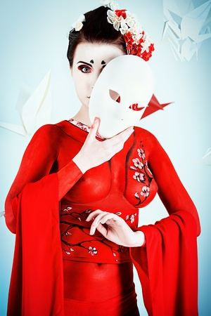 Art portrait of a stylized Japanese geisha with mask. Body painting project. Stock Photo - 20955828