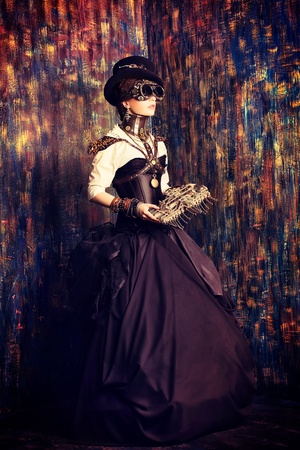 steampunk: Portrait of a beautiful steampunk woman over grunge background.