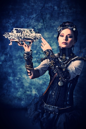 Portrait of a beautiful steampunk woman over grunge background. Stock Photo - 20955864