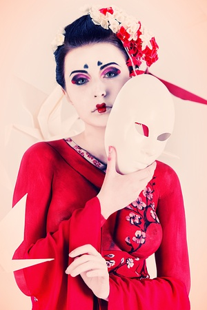 Art portrait of a stylized Japanese geisha with mask. Body painting project.  Stock Photo - 20955867