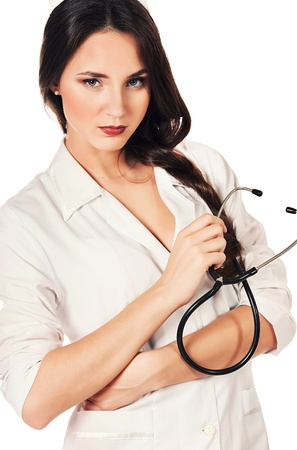 sexy female doctor: Portrait of a medical employee standing with a stethoscope. Isolated over white.