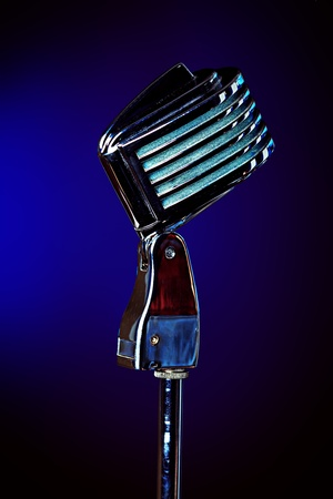 Old fashioned microphone over dark background. photo